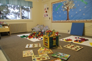 Toddler room puzzles and blocks at Children's co-op preschool in Bellingham