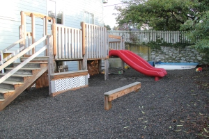 Outdoor fenced private play space at Children's Co-Op Preschool in Fairhaven Bellingham WA