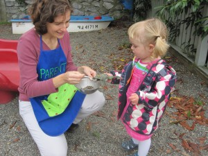 Toddler and parent helper on the playground at Children's Co-Op Preschool in Bellingham, WA