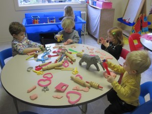 Toddler class members playing with play dough at Children's Co-Op Preschool in Fairhaven, Bellingham, WA