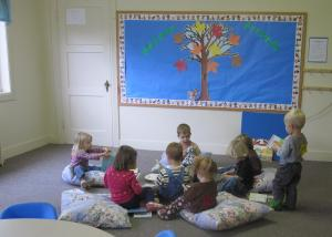 Toddler class reading at Children's cooperative preschool in Bellingham, WA